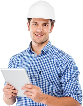 Property rehab contractor in hard hat standing and using tablet