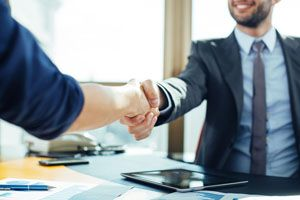 Business handshake for successful cooperation of property management in the office
