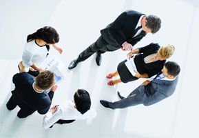 Top view of business meeting in which standing people with property management documents